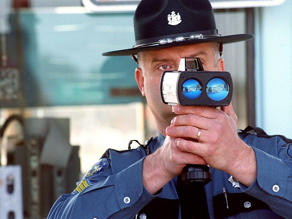 An officer and a handheld radar gun