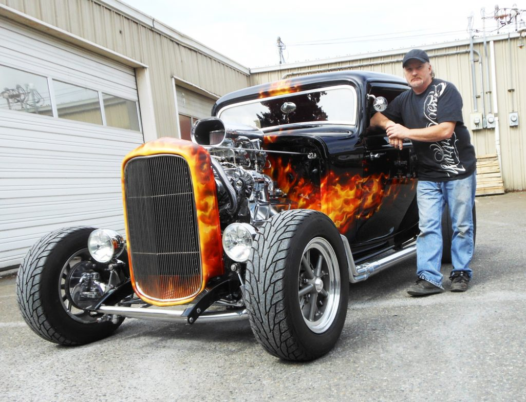 Custom paint and airbrush master Mike Lavallee stands by a sample of real-like flames created using his True Fire technique and templates