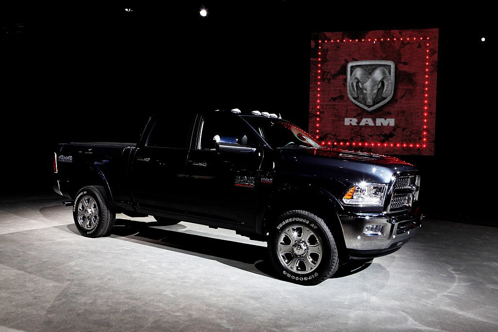 A black heavy duty Ram pickup truck on display at an auto show