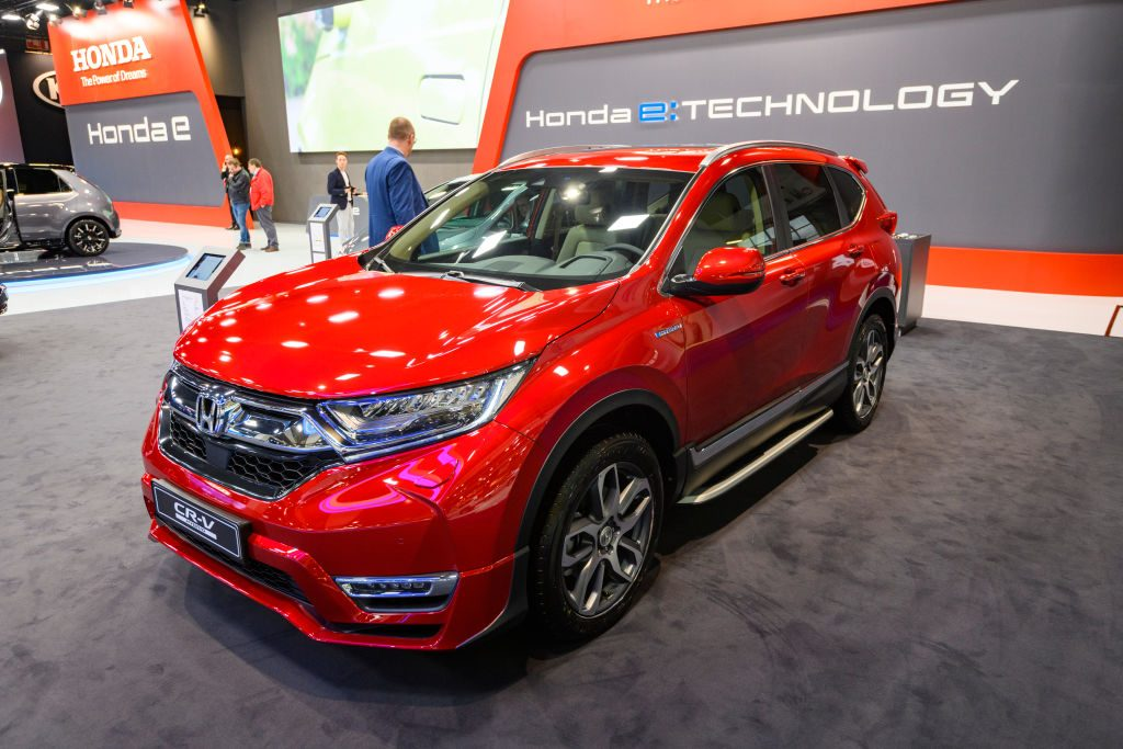 A red Honda CR-V on displat at an auto show