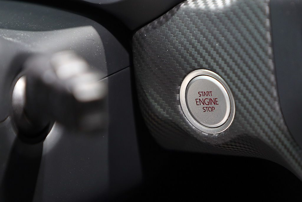 The engine ignition start/stop button of a Volkswagen XL1 plug-in diesel-electric hybrid automobile