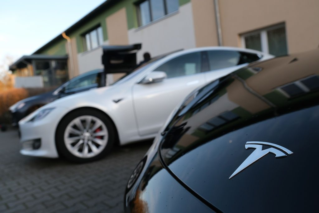 Electric cars of US automaker Tesla stand outside the Hangelsberg community center