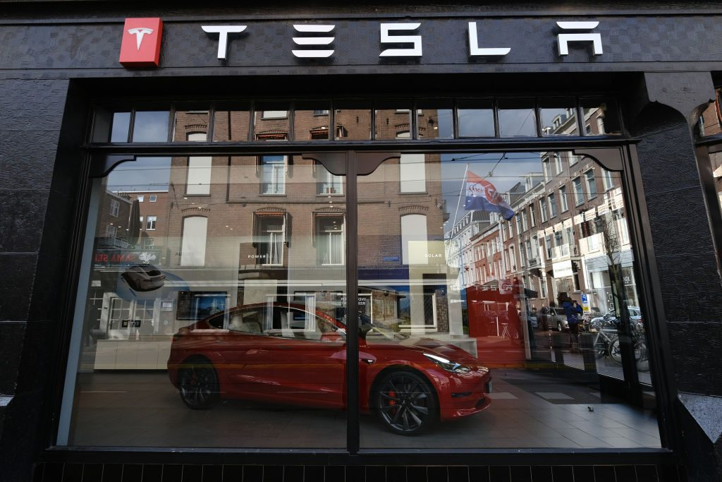 A logo of Tesla is seen outside its showroom