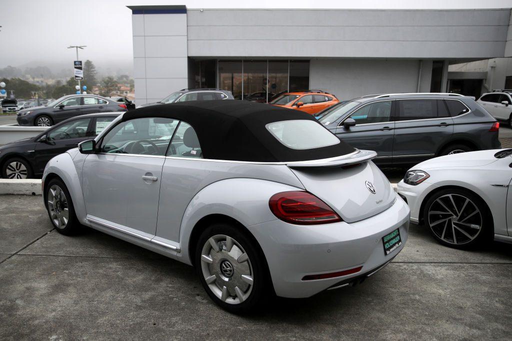 A brand new convertible Volkswagen Beetle is displayed on the sales lot at Serramonte Volkswagen