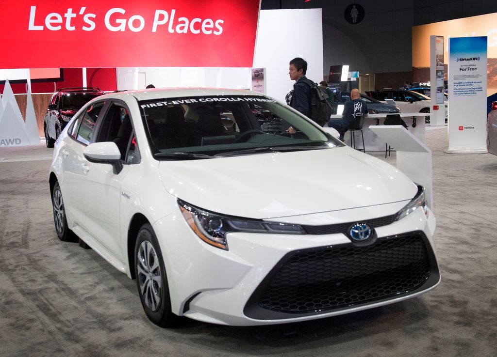 A 2020 Toyota Corolla Hybrid on display at an auto show