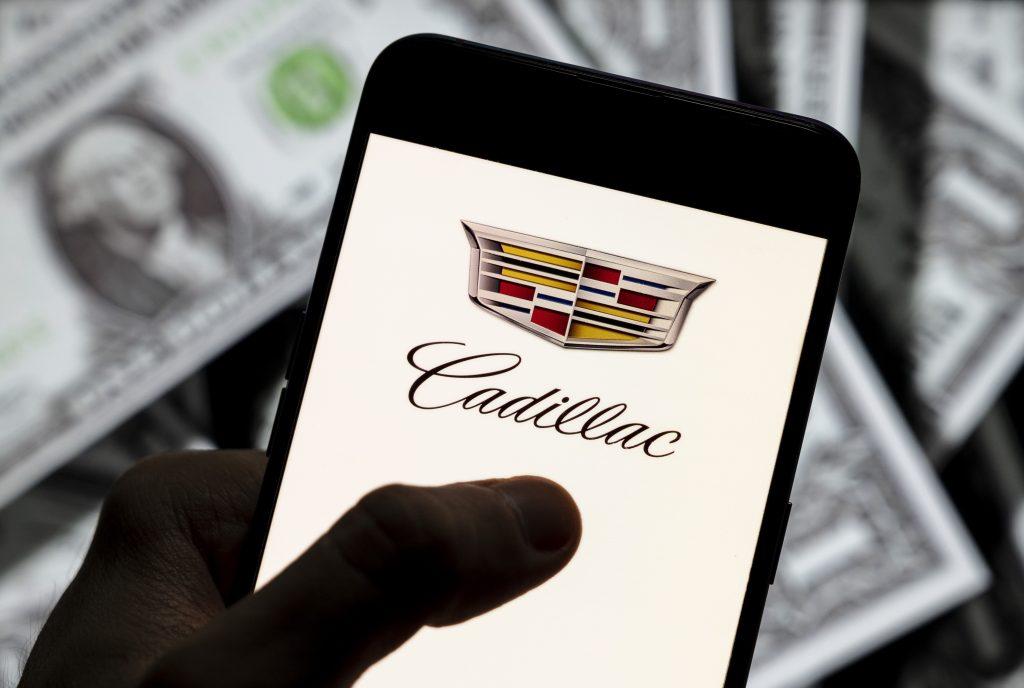 Cadillac badge displayed on a smart phone