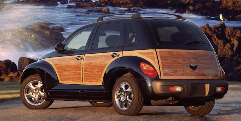 A PT Cruiser with a woody package sits by the water