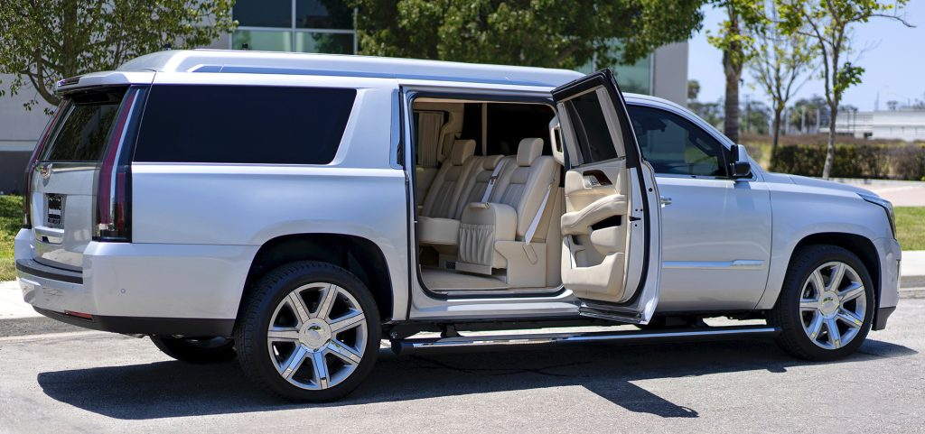 Tom Brady's 2018 Stretched Becker Cadillac Escalade ESV with the rear door open for a peek at the plush interior