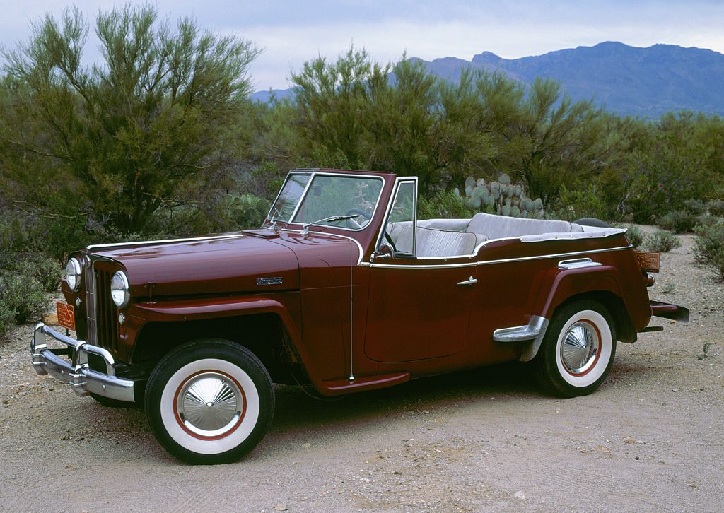 1948 Willys Jeepster parked at the beach