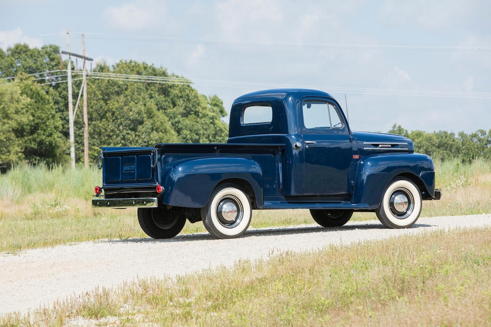 Dark blue 1949 Mercury pickup truck with whitewall tires, side-rear view