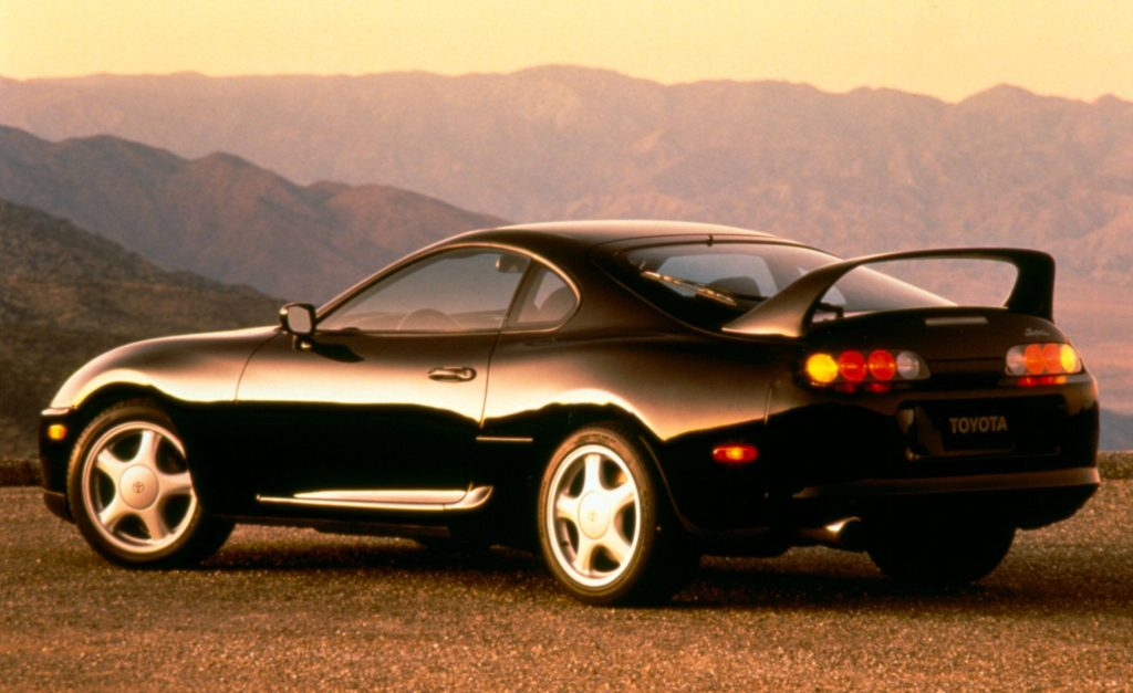 A black 1994 Toyota Supra that features the sporty design and agressive rear spoiler drivers fell in love with.