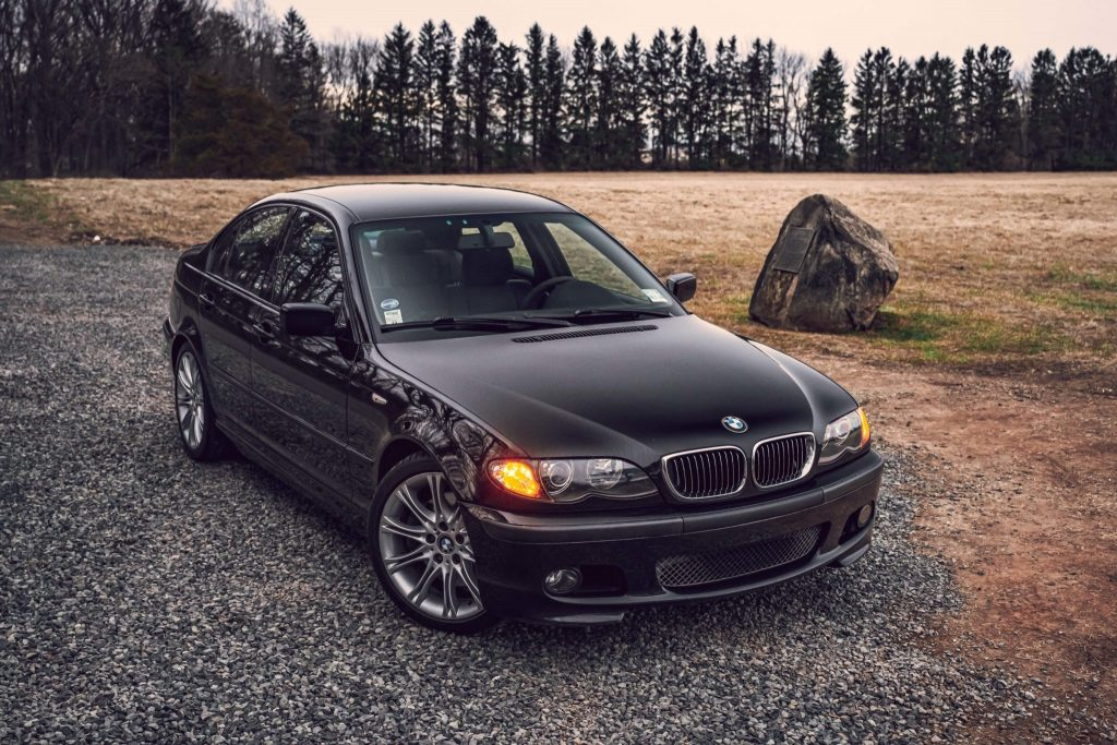 Black 2003 BMW E46 330i ZHP sedan parked on rocky road