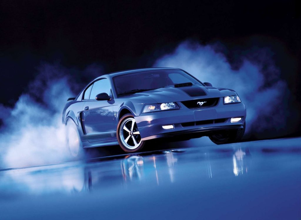 Blue 2003 Ford Mustang Mach 1 doing a burnout