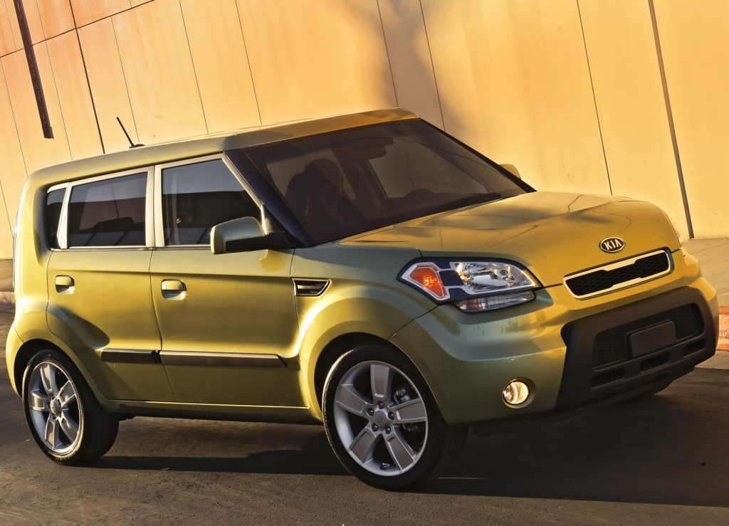 A bright green 2010 Kia Soul on the track.