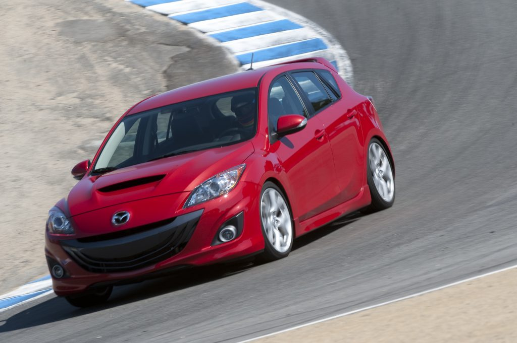 Red 2010 Mazdaspeed3 going around a corner