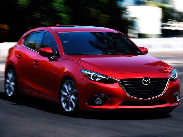 Bright red Mazda in drive mode.