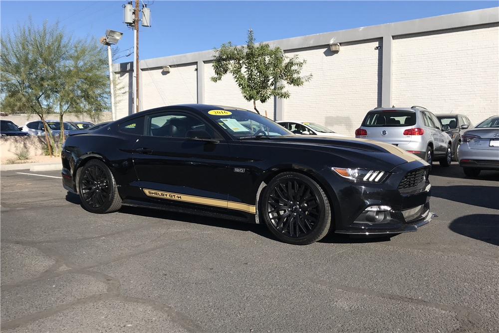 Side view of black-with-gold-stripes 2016 Shelby GT-H Mustang in parking lot