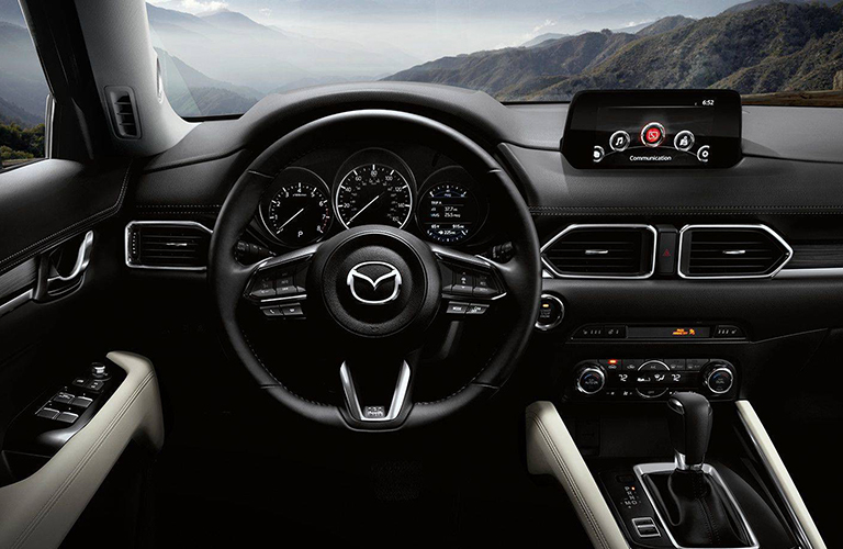 The interior of the 2018 CX-5 features of mix of upscale finshings and trimmings.