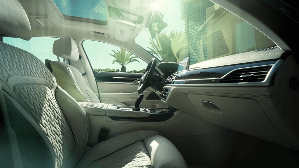 2020 Alpina B7 interior, showing white quilted leather seats and dark wood trim
