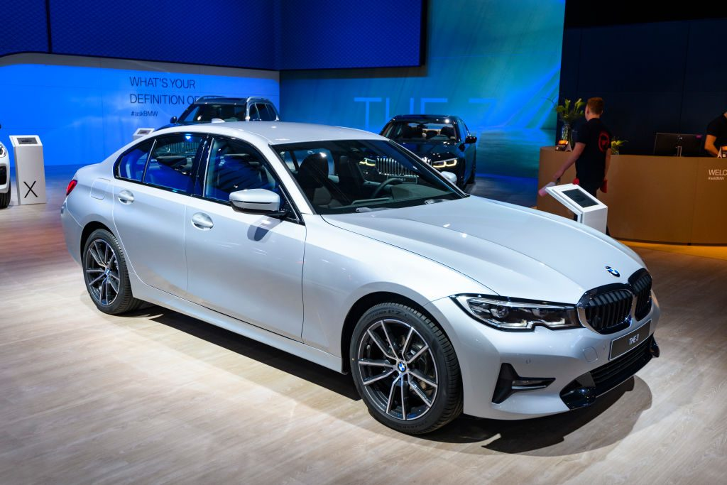 A 2020 BMW 3 Series on display at an auto show