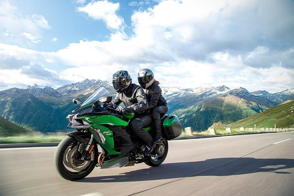Green 2020 Kawasaki Ninja H2 SX SE+, with 2 riders on a mountain road