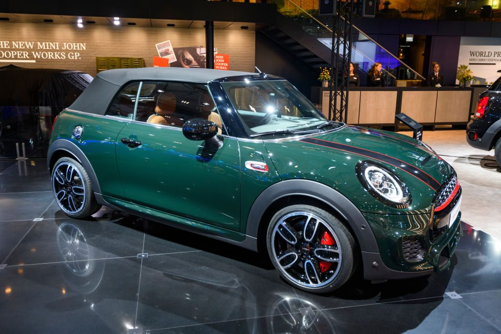 A Mini Cooper convertible on display at an auto show