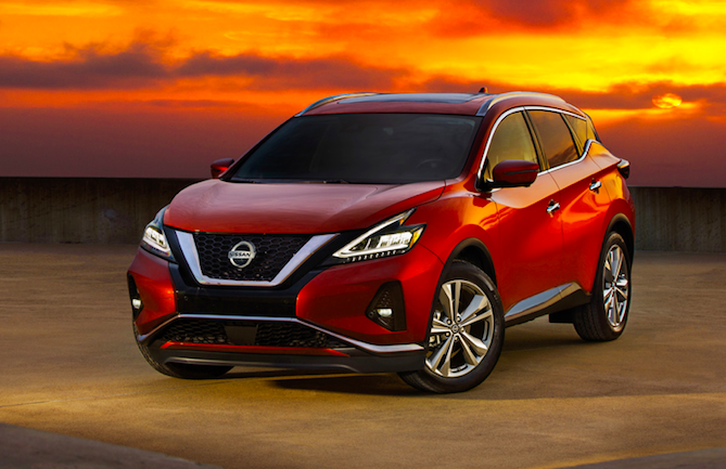 A red 2020 Nissan Murano crossover parked out in a desert, a winner pf the J.D. Power quality award.