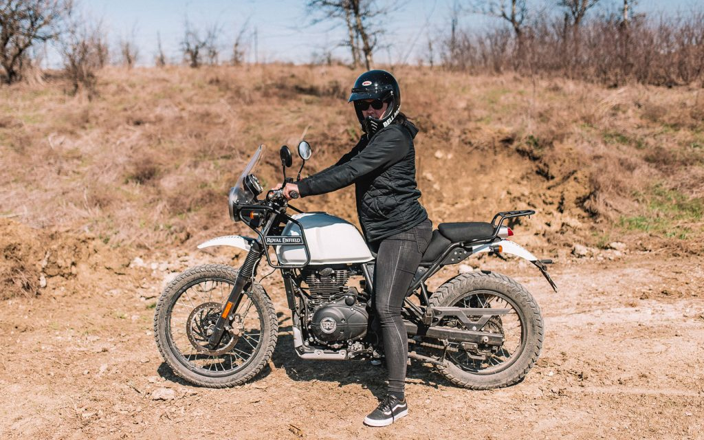 Rider sitting on 2020 Royal Enfield Himalayan on a muddy road
