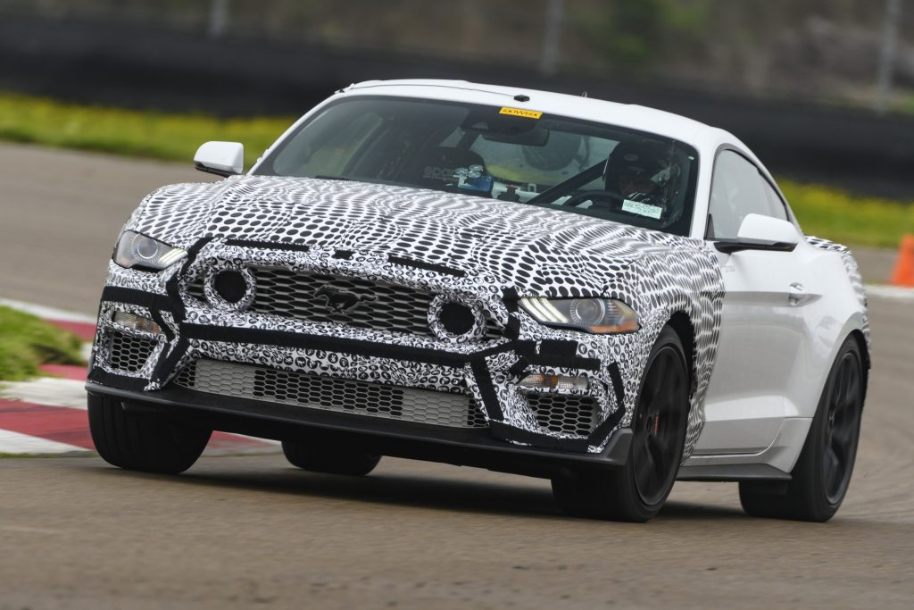 White-and-black camouflaged 2021 Ford Mustang Mach 1 testing on the racetrack