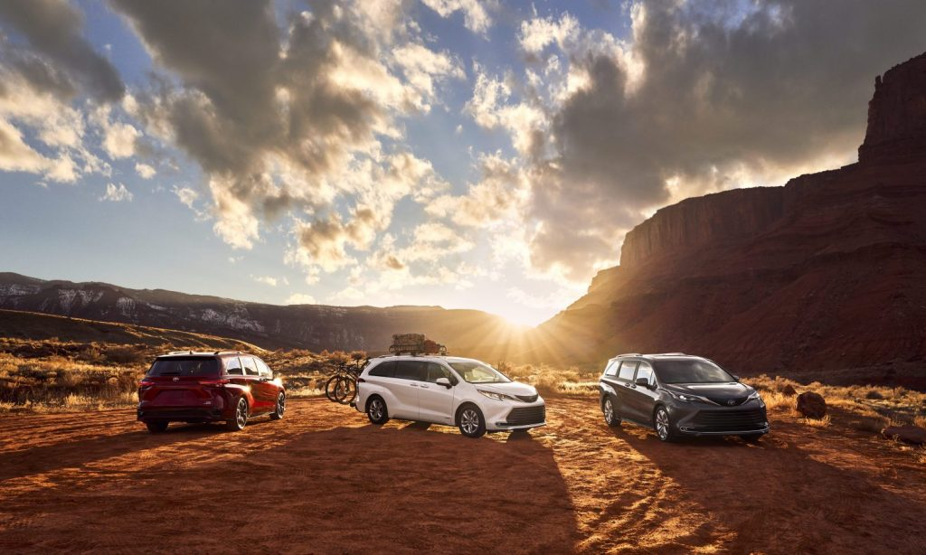 red, white, and silver 2021 Toyota Siennas in the desert