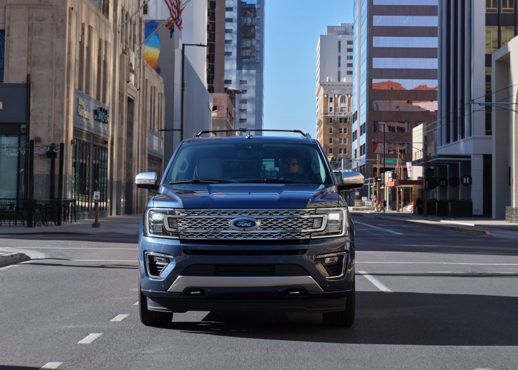 2020 Ford Expedition Platinum trim model driving in the city
