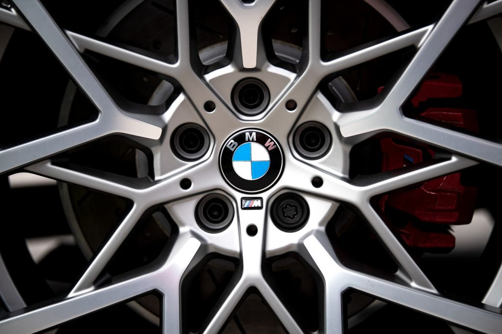 The logo of the Munich car manufacturer BMW can be seen on the rims of a car