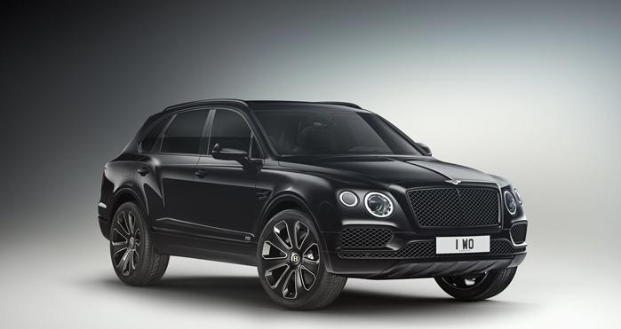 a press photo of a black Bentley Bentayga SUV