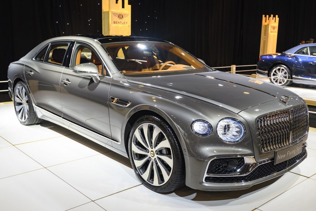 A charcoal colored Bentley Flying Spur sits on display at a car show