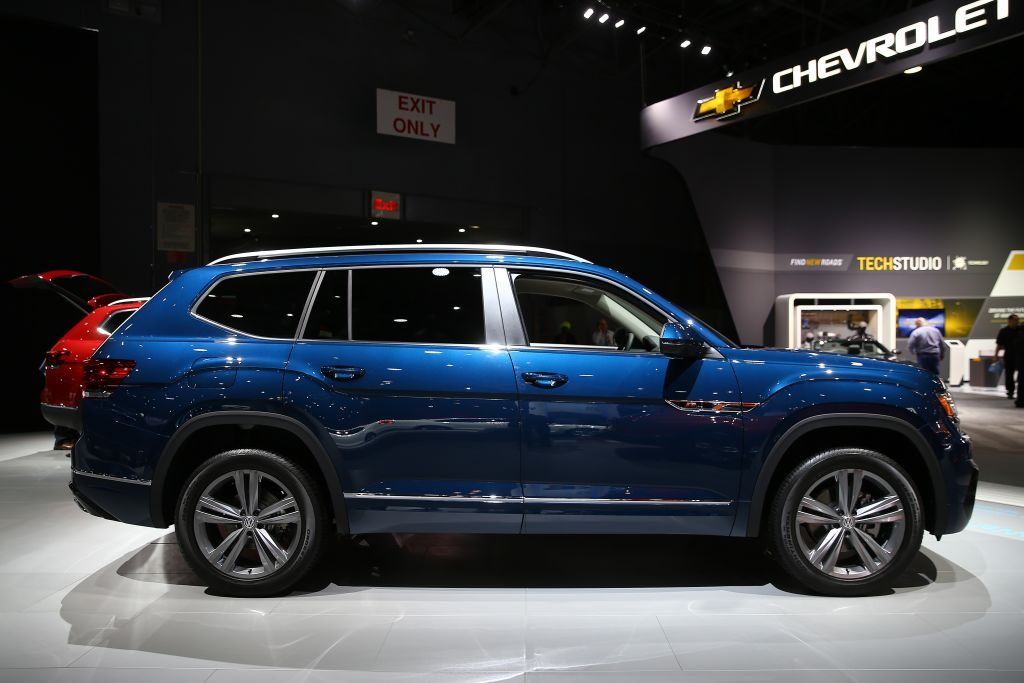 A blue Volkswagen Atlas on display at an auto show