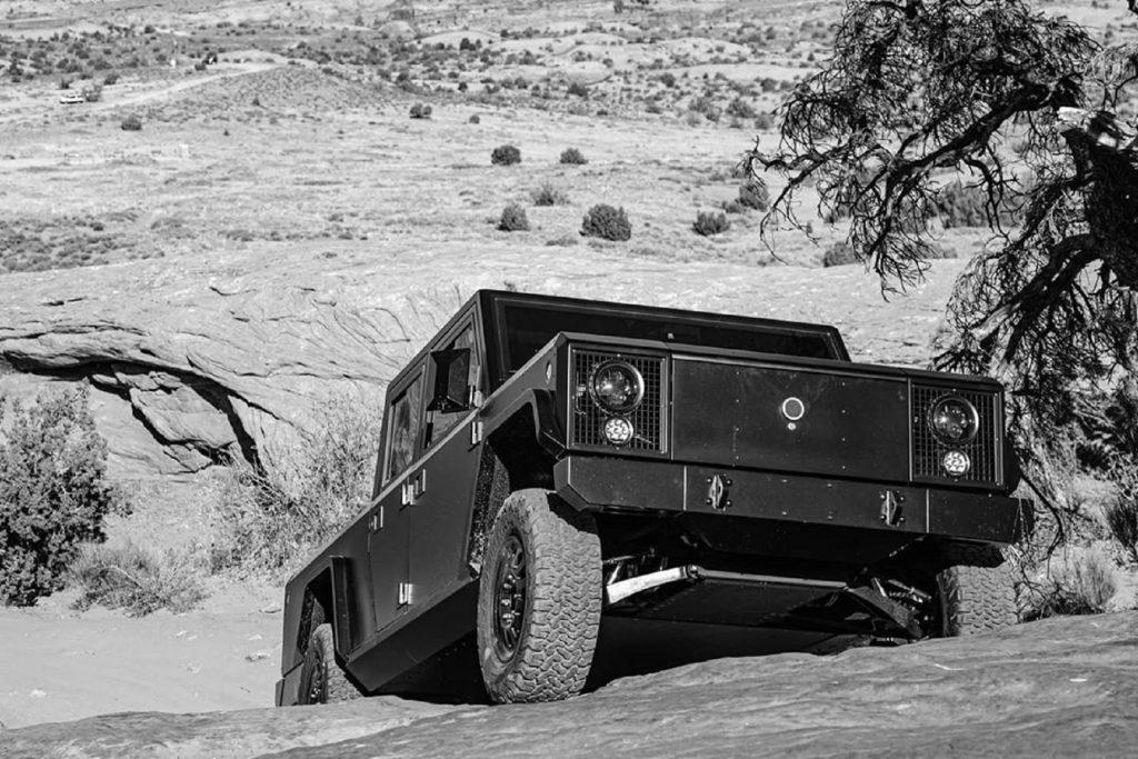 Bollinger B2 electric truck climbing up a rocky hill