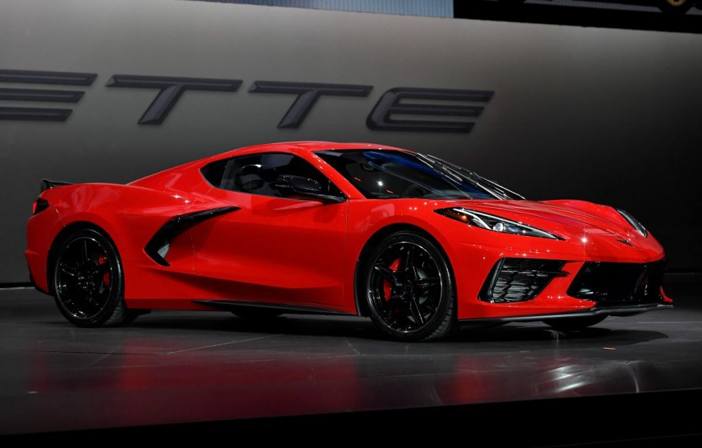 A 2020 Corvette C8 on stage at a car show