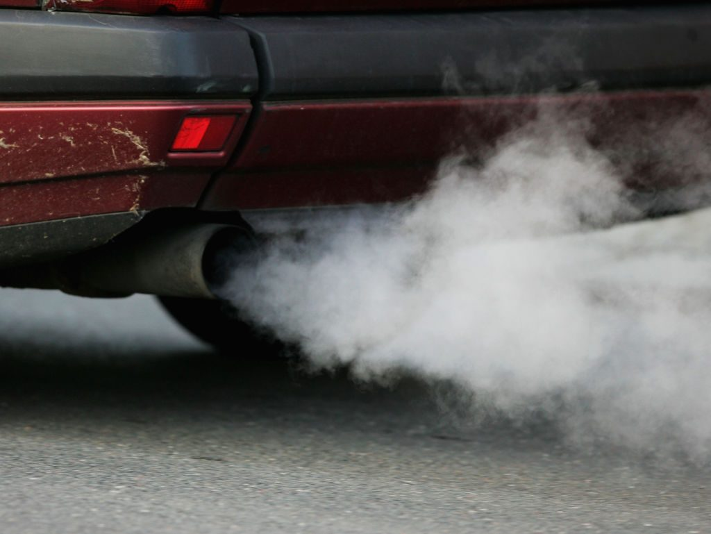 Car emissions coming from the tailpipe of a car