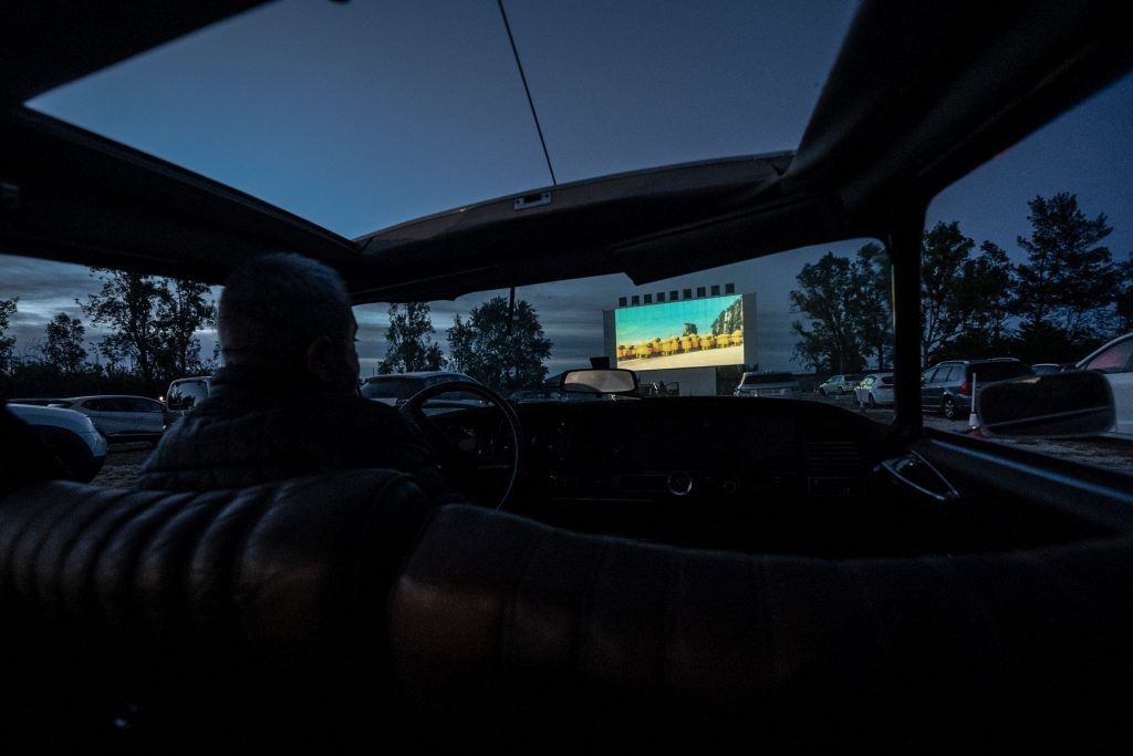 View of the drive-in screen from inside a vehicle at night time