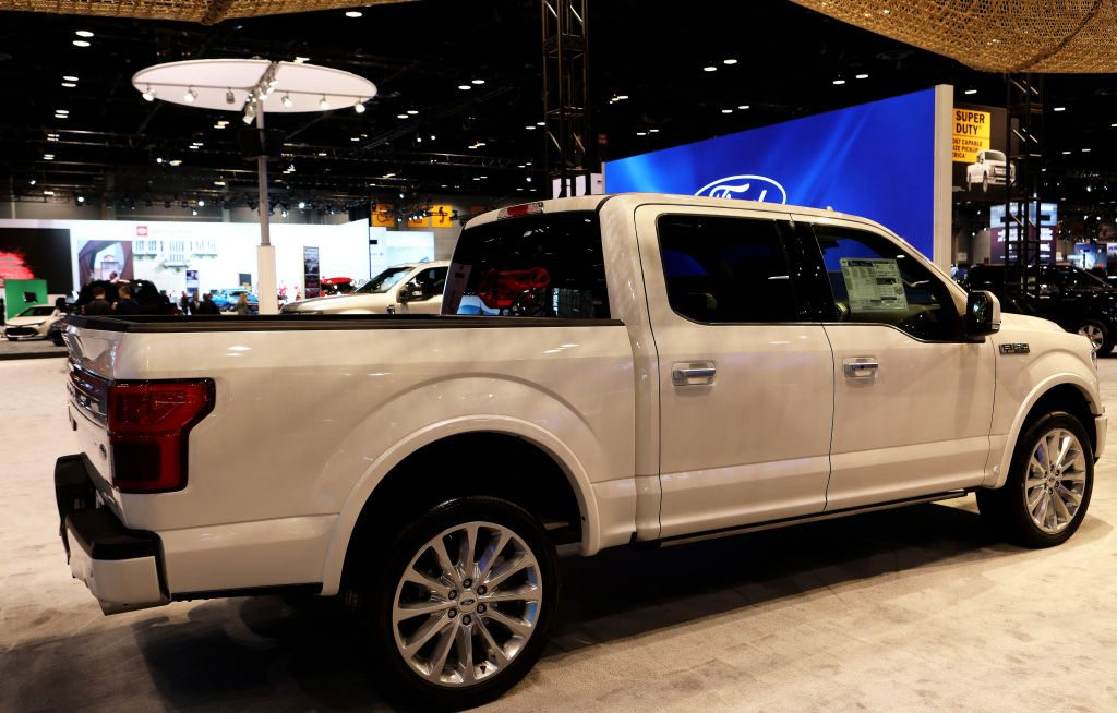 A white Ford F-150 on display at an auto show