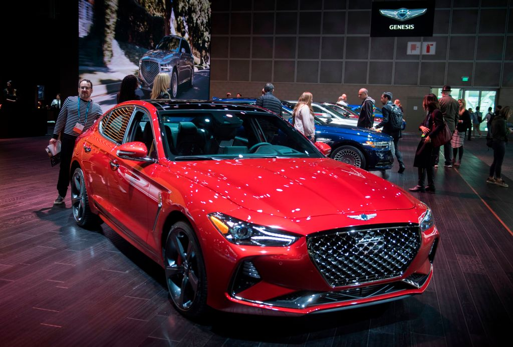 red genesis g70 at an auto show