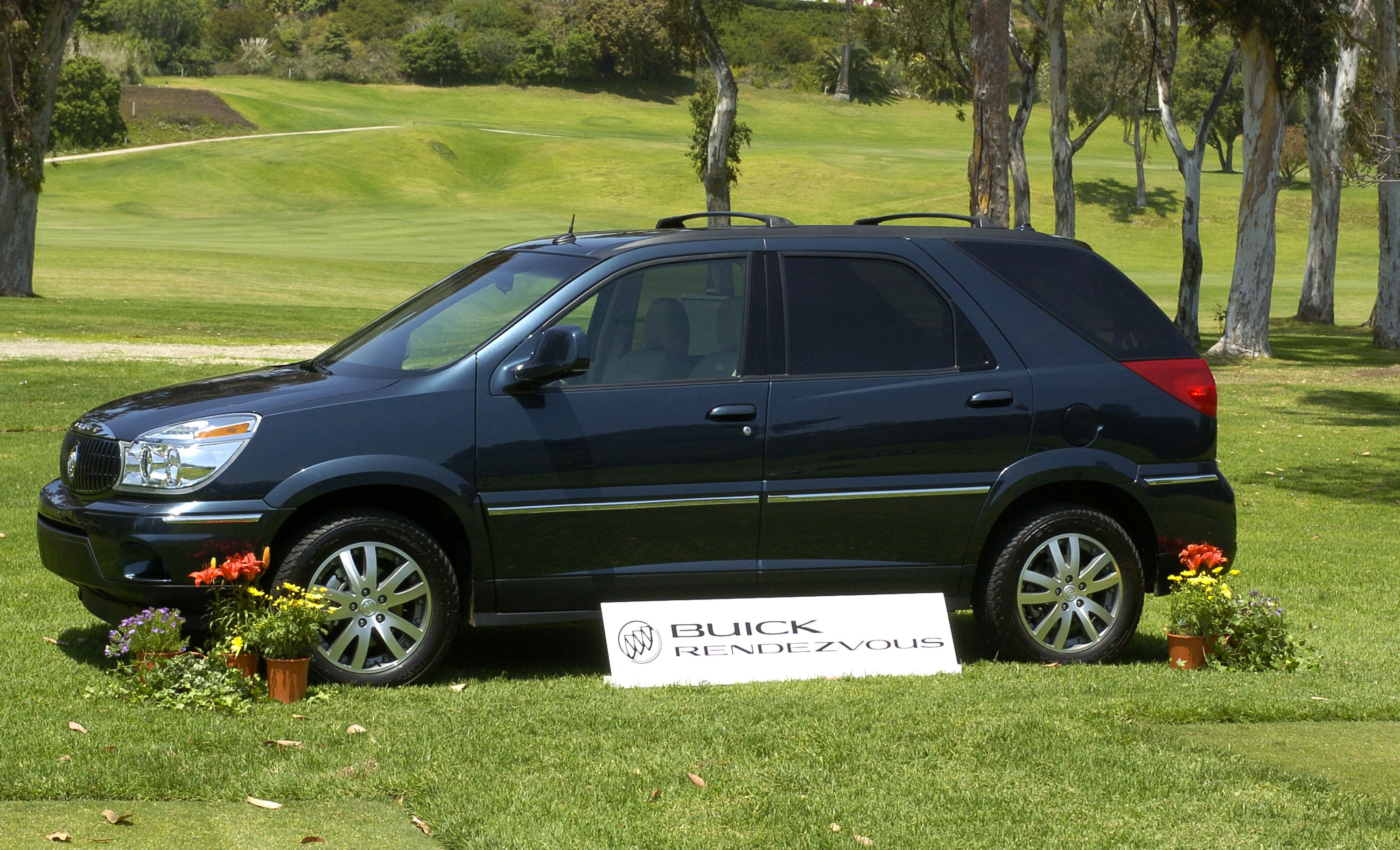 A Buick Rendezvous on display in the grass