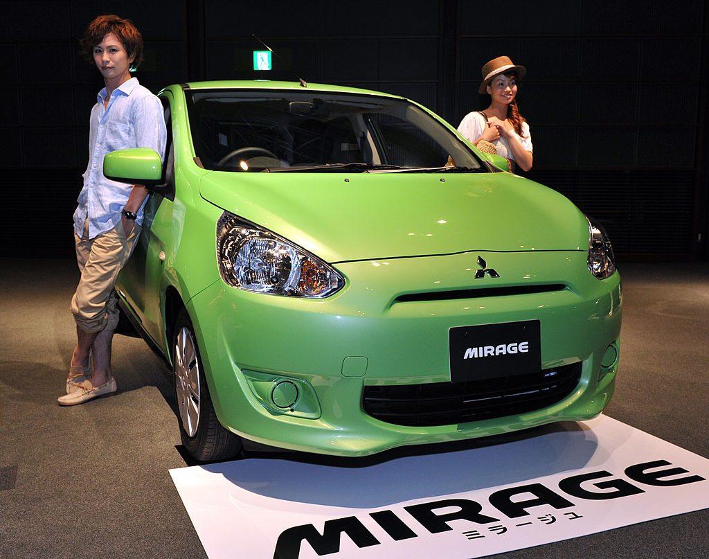 A green Mitsubishi Mirage on display at an auto show