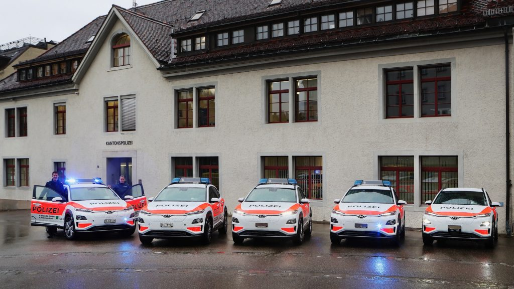 Hyundai Kona Electric Police Cars lined up in front of a station in Switzerland