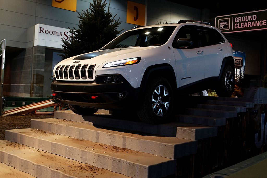A Jeep Cherokee makes its way through the 'Camp Jeep Test Track' at the 108th Annual Chicago Auto Show