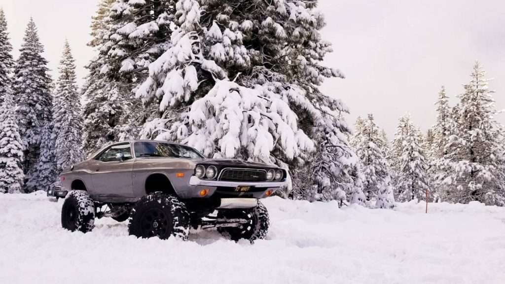 Lifted 1973 Dodge Challenger 4x4 in a snowy forest
