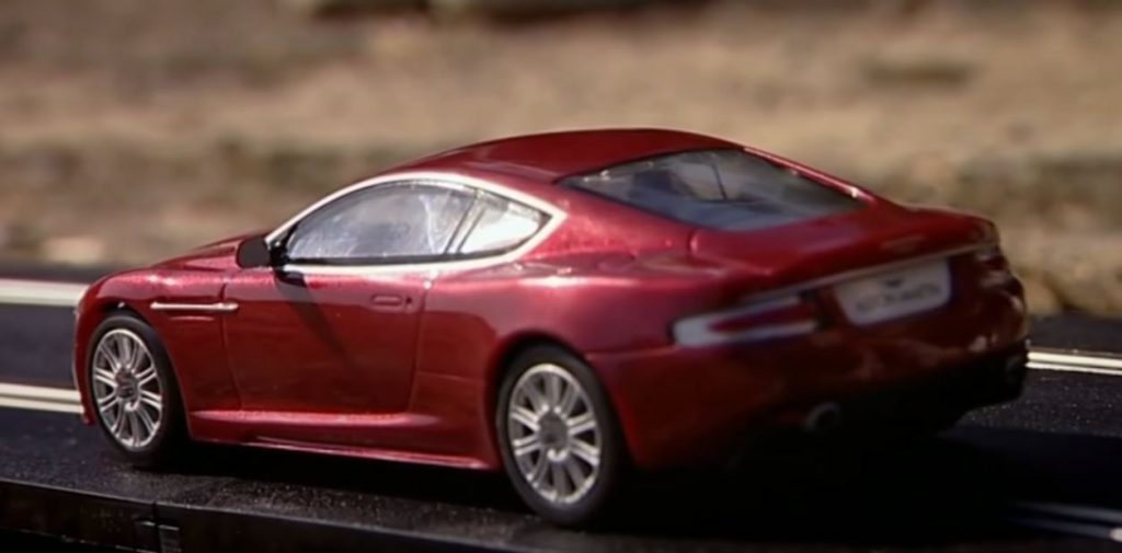 Maroon Aston Martin on Slot Track