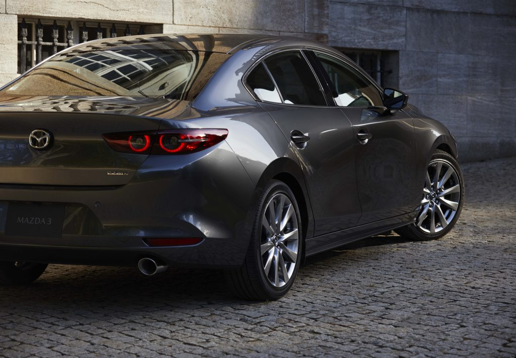 the rear view of a gray Mazda 3