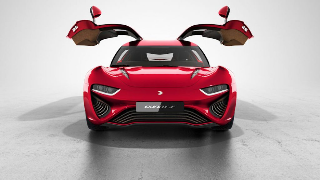 A head-on view of a red electric Quant FE with its gull wing doors open