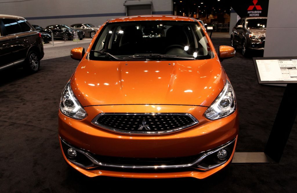 An orange Mitsubishi Mirage on display at an auto show